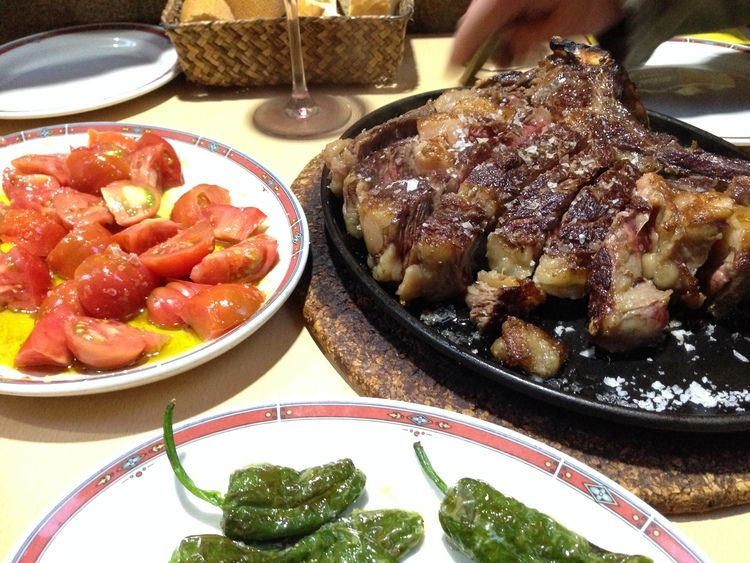 Aged beef rib chop, tomato salad and gernika green peppers from Bar Nestor