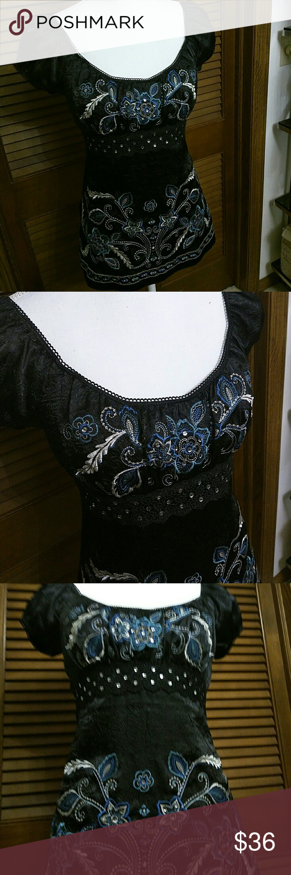 Embroidered Top with rhinestones details. Gorgeous top with embroidery and rhinestones details, lace details. Flawless. Worn once. Zipper on the side. Ties on the back. Brand tag cut off(was bothering me) don't remember brand. Anthropologie for viewing only. Anthropologie Tops