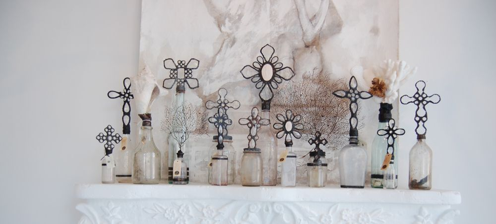 White flowers homewood al choice image flower decoration ideas glass bottles with crosses on the caps this arrangement is from glass bottles with crosses on mightylinksfo Choice Image