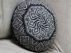 Cushion cover designed to use up small quantities of Shetland yarn.