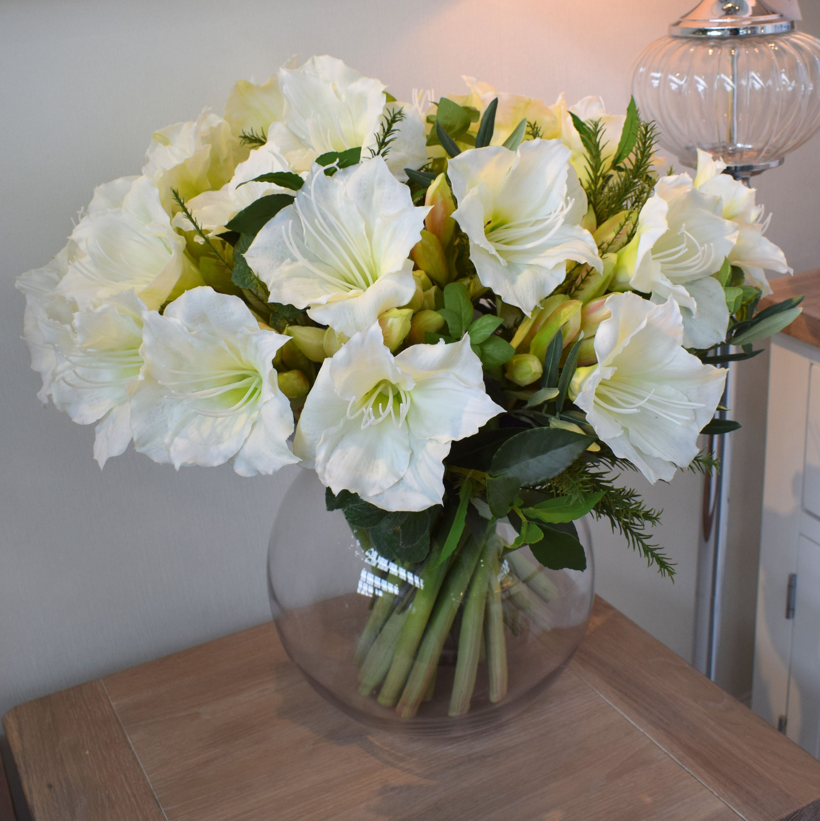 Artificial Flower Arrangement Of White Amaryllis And Herbs In A