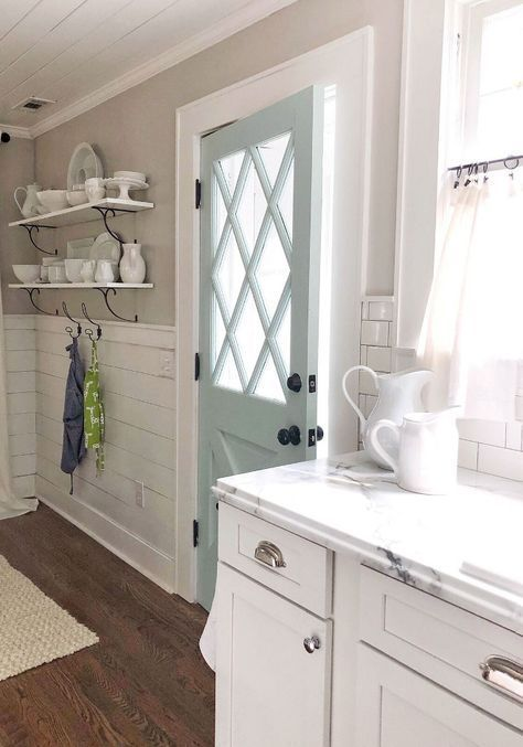 Sherwin Williams Agreeable Gray Farmhouse kitchen with shiplap paneling and neutral wall paint color Sherwin Williams Agreeable Gray #SherwinWilliamsAgreeableGray #Shabbychickitchen #sherwinwilliamsagreeablegray