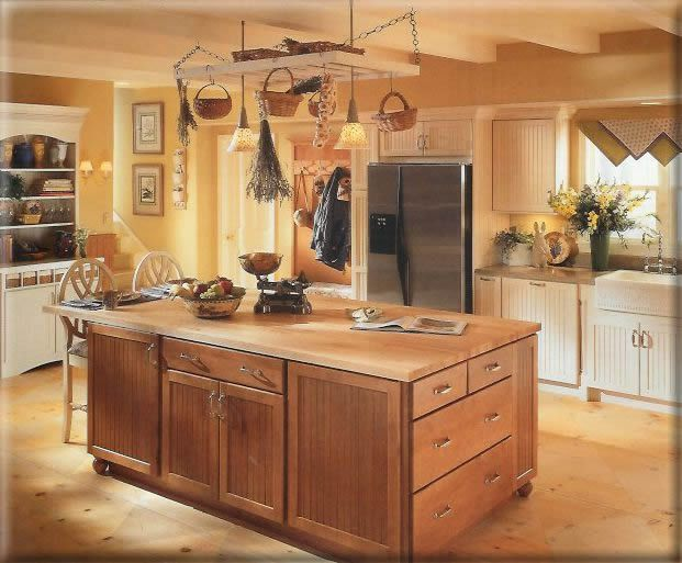 lovely kitchen...yellow walls. light brownish butter ...
