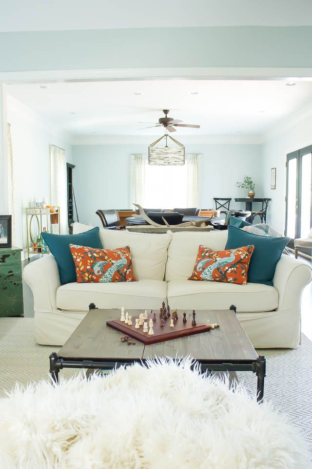 Teal and orange add the perfect pop of fall color in this family teal and orange add the perfect pop of fall color in this family game room solutioingenieria Image collections
