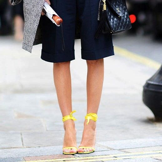 Bermuda shorts, yellow sandals