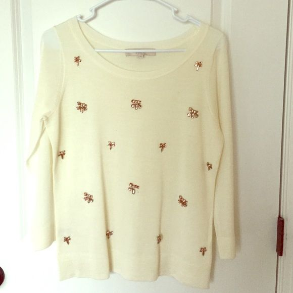Loft Crystal Sweater Beautiful pink crystals adorn the ivory sweater. Sweater is slightly opaque and may require a camisole. One jewel has fallen off the front of sweater. LOFT Sweaters Crew & Scoop Necks