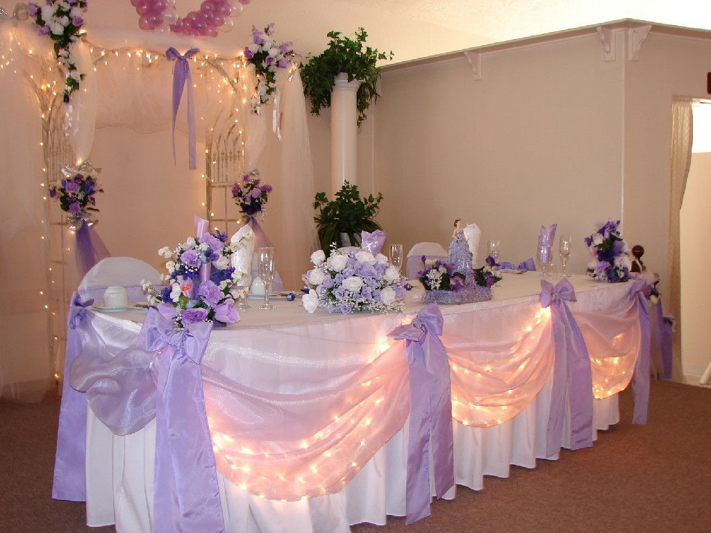 Lavender and white head table decor wedding reception for Wedding party table decorations
