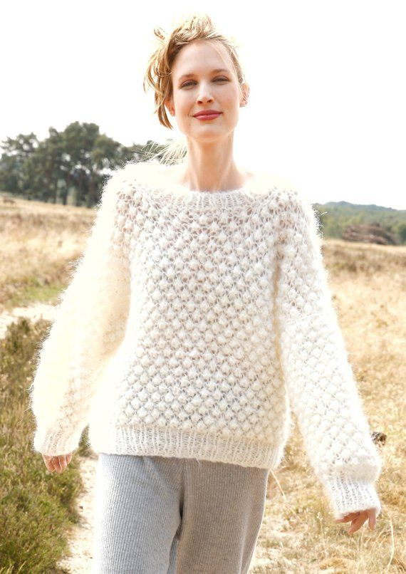 Knit white oversize mohair sweater with a pattern of cones