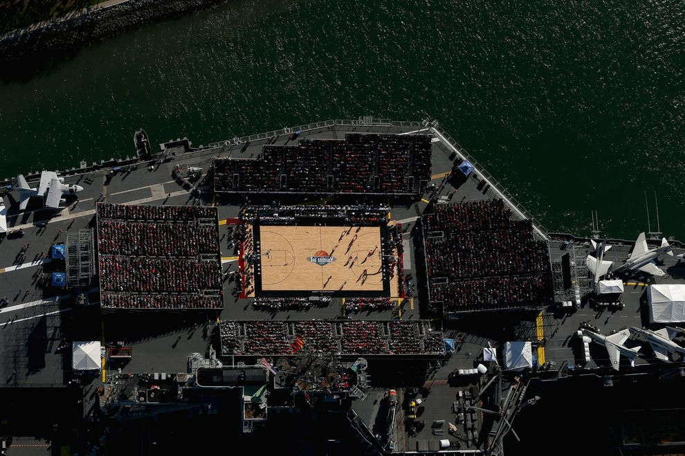 21 Breathtaking Photos Of A College Basketball Game Played On An Aircraft Carrier College Basketball Game College Basketball Basketball Games Online