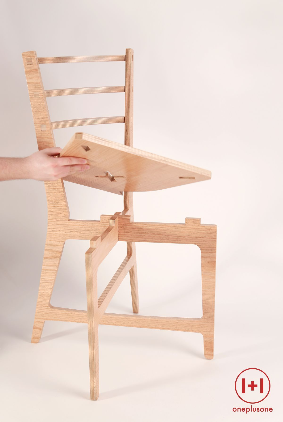 CNC cut plywood chair with no need of glue or fixation bolts just clipping the parts by pressure fitting Manufactured at the Fab Lab Barcelona