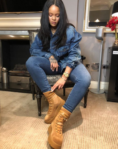 2efdd49bf765 Rihanna wearing the high ankle lace up Scuba Boots by FENTY X PUMA ...