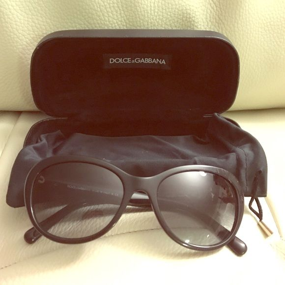 Dolce & Gabbana Sunglasses Beautiful Dolce & Gabbana Sunglasses! Black with gold detail on either side. Slight scratch on the left lends but hardly noticeable (see picture). Comes with case and sleeve cover as well. Dolce & Gabbana Accessories Sunglasses