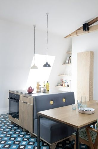 Small space? Ingenious space saving kitchen- chef's island with built-in bench seating. Encaustic tile floor. appartement sous les toits paris 11