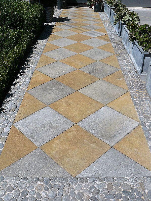 Garden Design Nursery jester paving with stone mosaic edging. designedhedge garden