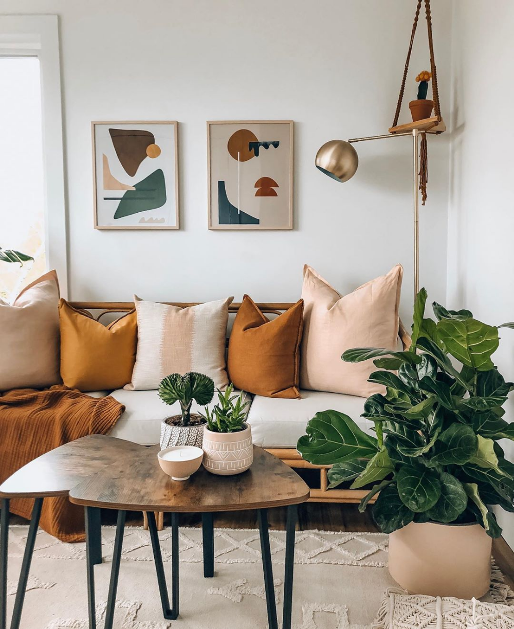 Neutral Boho Living Room With Mustard And Blush Rattan Sofa Sculptural Plants And Modern Abstract Art Living Room Designs Living Room Decor Boho Living Room #neutral #bohemian #living #room