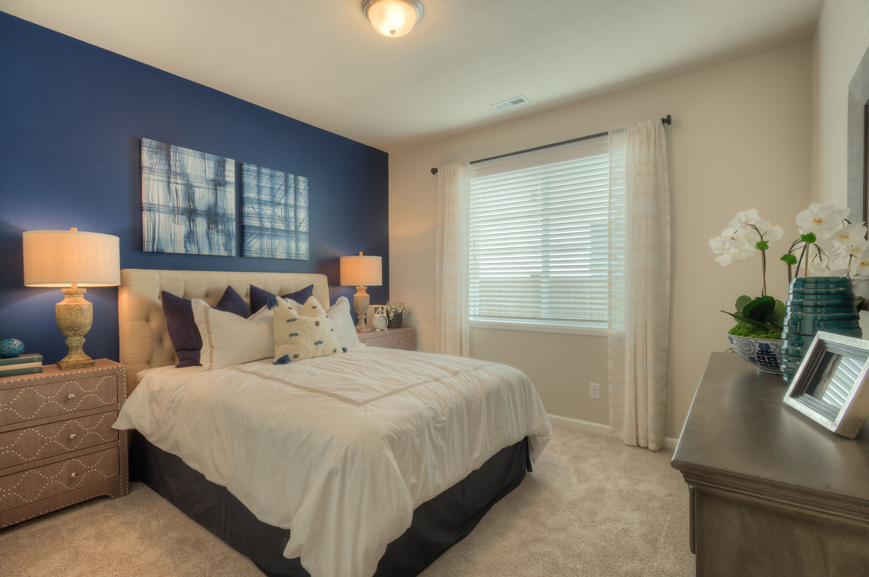 This Accent Wall Is Indigo Batik By Sherwin Williams And Looks Amazing Next To The Creamy Accessible Beige Beige Room Beige Bedroom Paint Colors Beige Bedroom