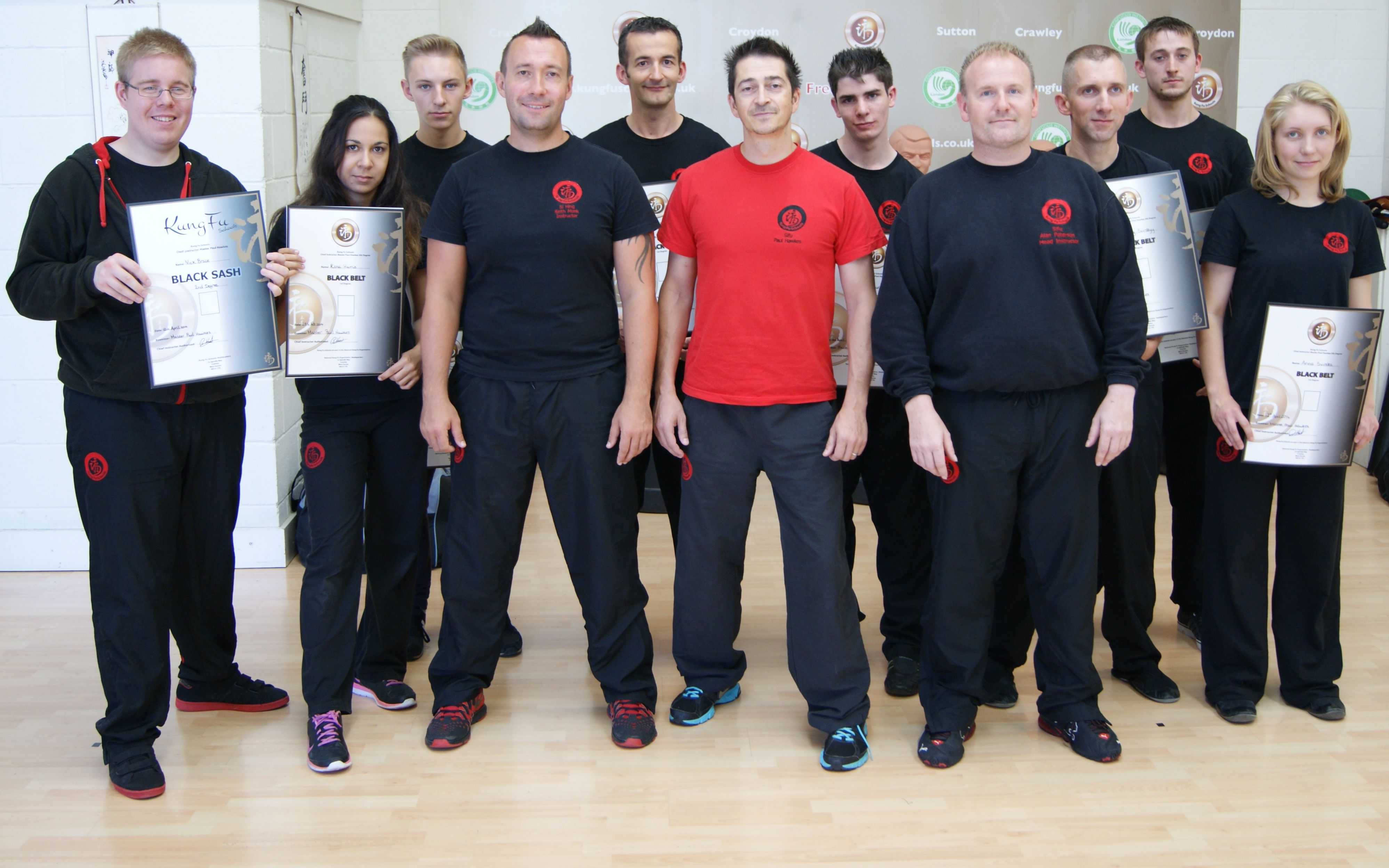 Adult Students Of Kung Fu Schools Croydon And Sutton Receiving Their Degree Certificates
