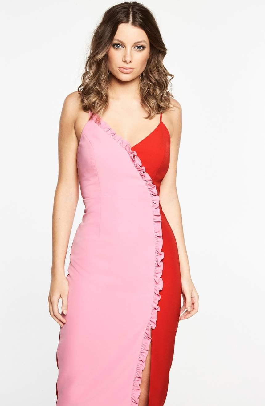 Femme ruffles accentuate the flirtatious style of a flattering, faux ...