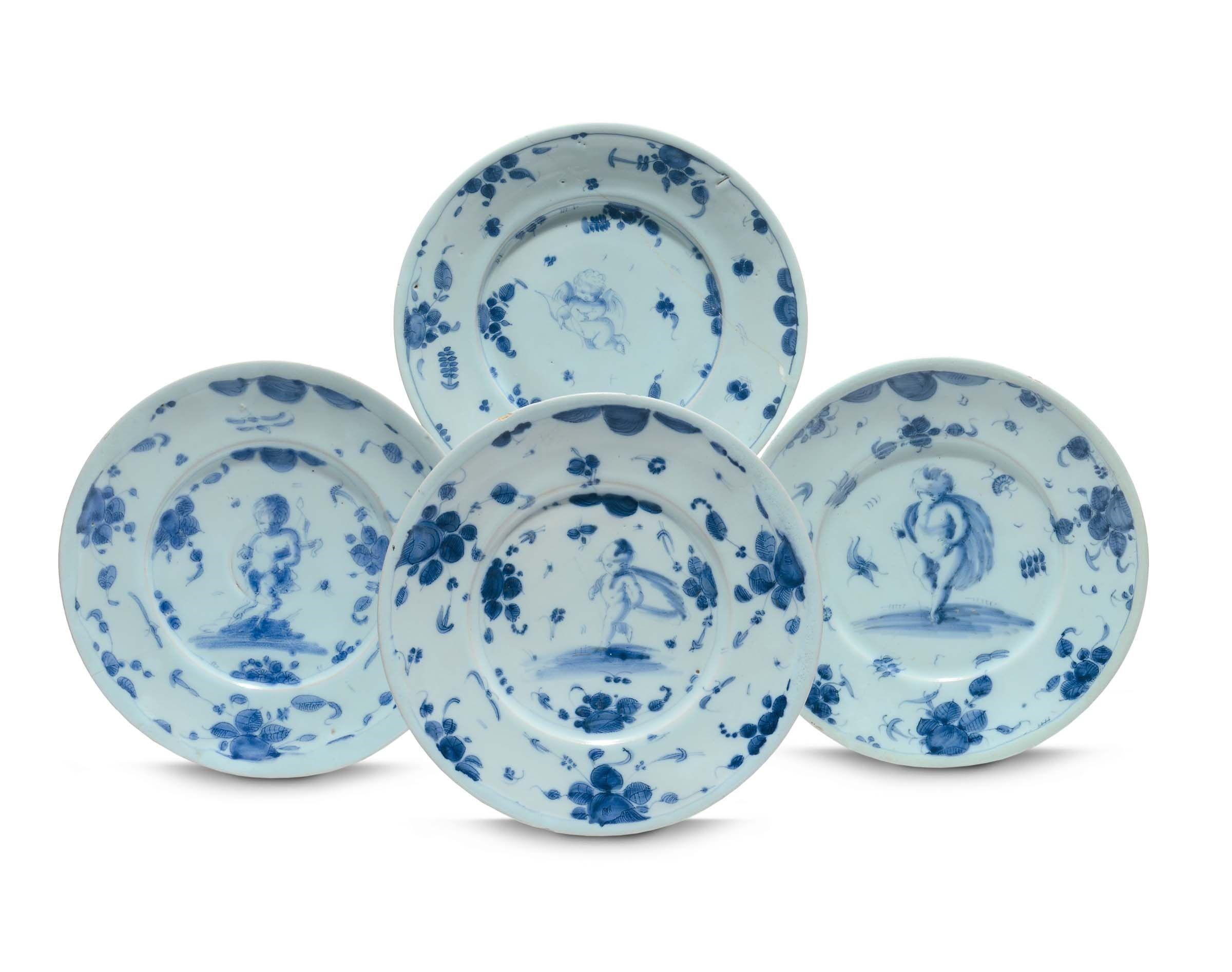 Quattro piatti in maiolica a decoro di fiori e figure savona marca