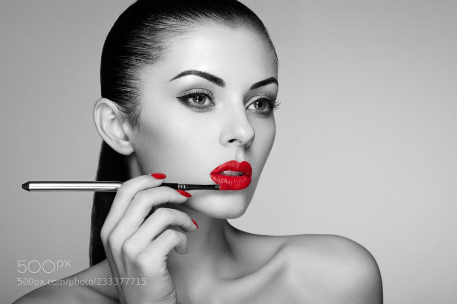 Black and white photo of woman painting lipstick by heckmannoleg