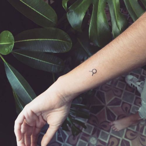 tiny taurus zodiac sign tattoo on the left wrist tattoo