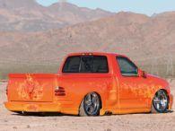 modified orange ford lightning | 2002 Ford F150 ob - Audio Upgrades - Lightning - Custom Truck Paint ...