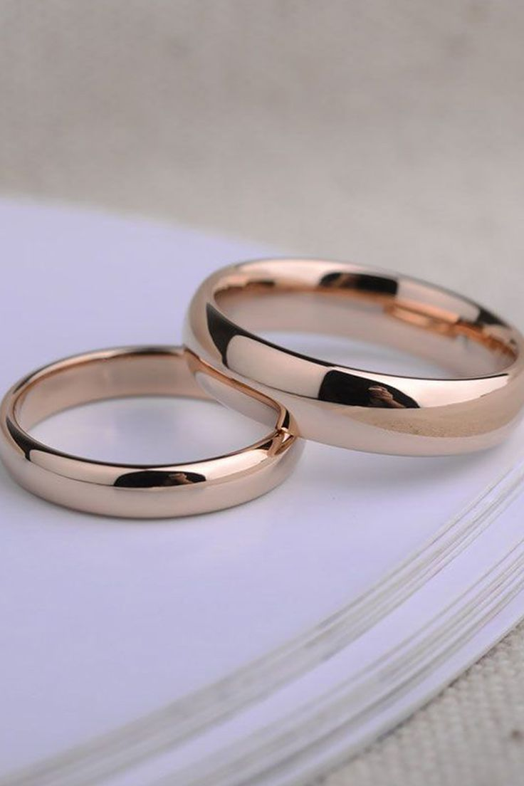 It is a graphic of Simple, humble and matching wedding bands. Wedding rings sets