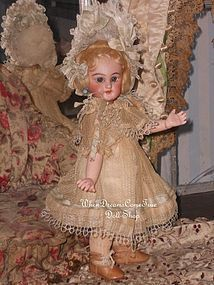 Tiny French Bisque Bebe with Paris Store Label - WhenDreamsComeTrue #dollshopsunited