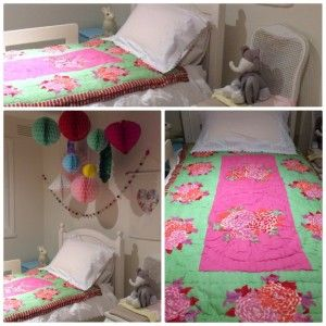 Little girls room. Beautiful Lisa Corti Pink and Green single bed quilt. I may have gone overboard with the garland and hanging tissue paper fans and balls but I love them!