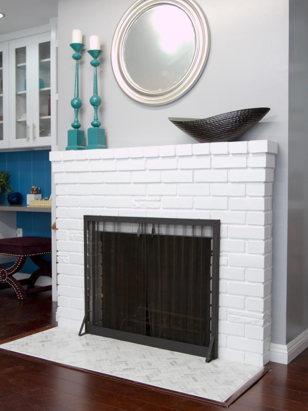 White Painted Brick Fireplace With Herringbone Tile Hearth Hgtv
