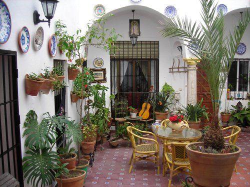 Mexican patio need to find blu plates el cortijo - Patios andaluces decoracion ...