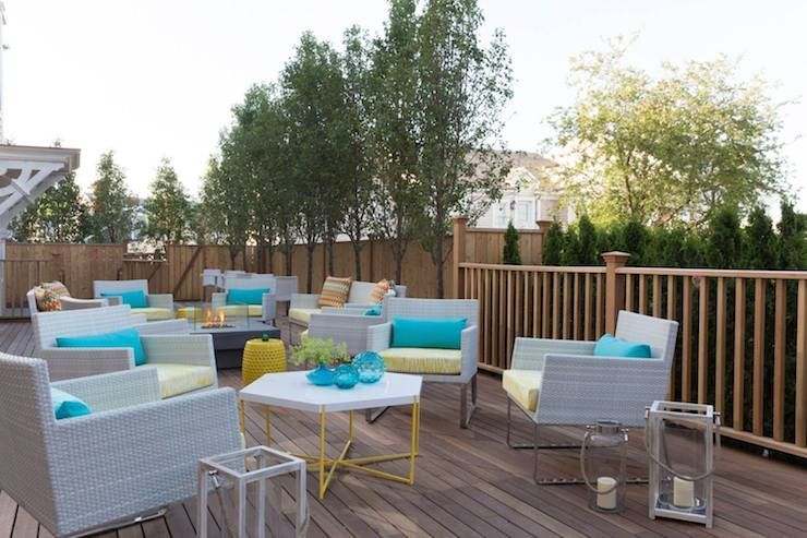 21 Broad Hotel Deck Features Gray Outdoor Chairs Accented With Yellow Cushions And Turquoise Pillows P Contemporary Outdoor Furniture Patio Outdoor Furniture