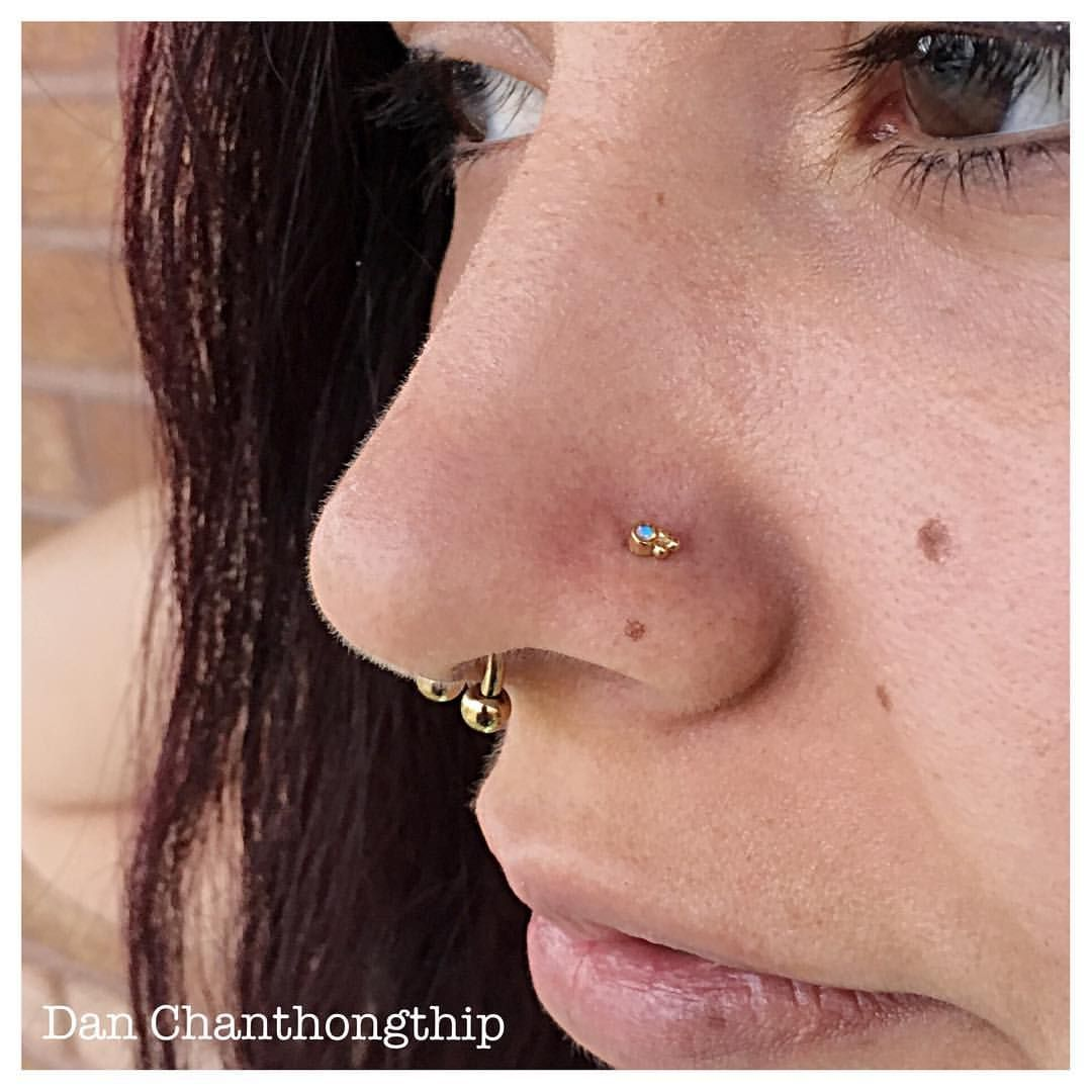 Nose piercing ripped out  k Yellow Gold Sabrina with faceted white Opal to match the septum