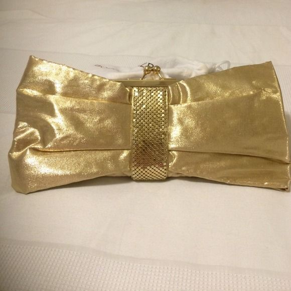 NWOT Kate Landry Gold Bow Clutch W Strap Brand New without Tags. Kate Landry gold bow clutch with strap. Gorgeous evening clutch. Measurements: 11 inches by 6 inches.  NO TRADES/NO PAYPAL  Please submit an offer if you are interested. Kate Landry Bags Clutches & Wristlets