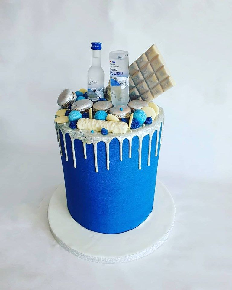 Blue and silver vodka drip cake in 2020 celebration