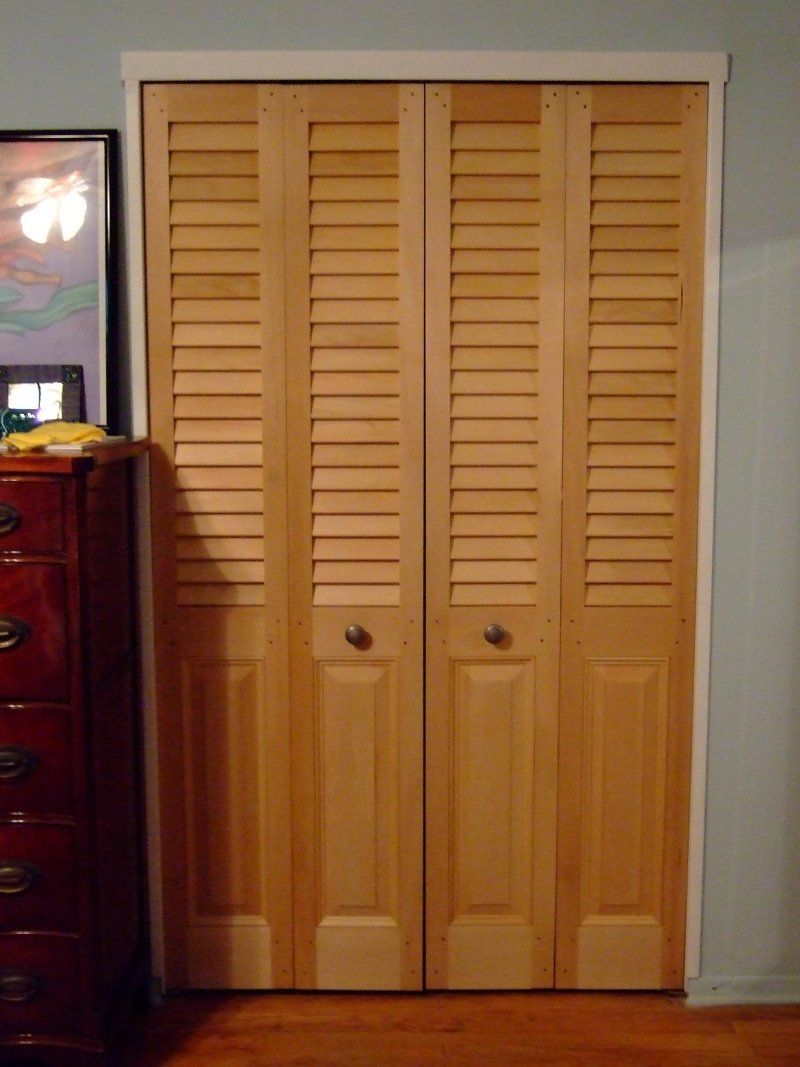 Custom sized bifold closet doors with fixed Plantation