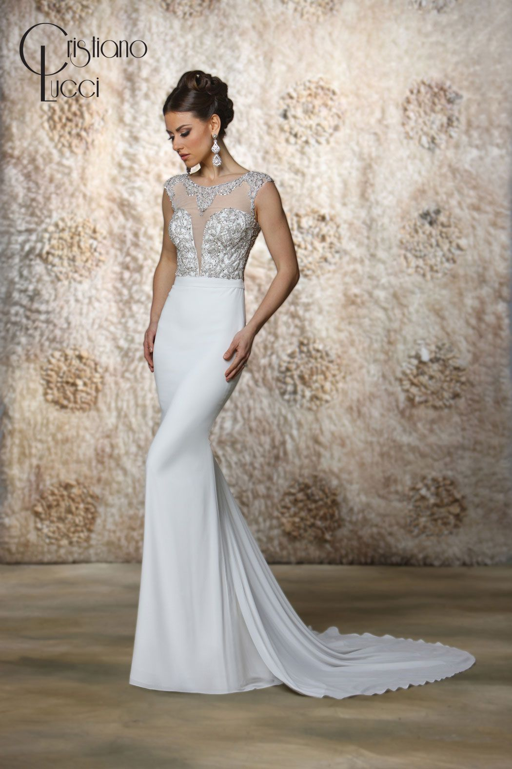 12931/Uma This soft chiffon sheath features a fully beaded  crystal bodice and neckline draping the shoulder and tracing the back. Finished with crystal buttons back closure Fabric: Chiffon+Tulle Available Color: Ivory/Nude, Ivory/Ivory White/Nude, White/White