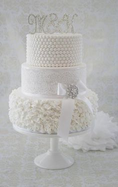 Beautiful All White Wedding Cake With Ruffles Stencilling And Pearls