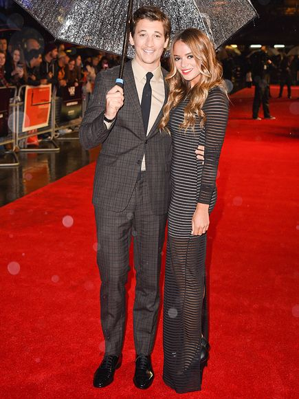 Star Tracks: Thursday, October 16, 2014 | RAIN CATCHER | Miles Teller shields girlfriend Keleigh Sperry from the London rain on Wedndesday night as they attend the premiere of his film Whiplash at the BFI London Film Festival.