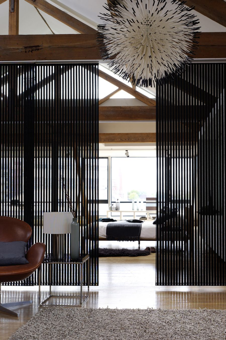 Vertical blinds make great room dividers in either a modern or ...