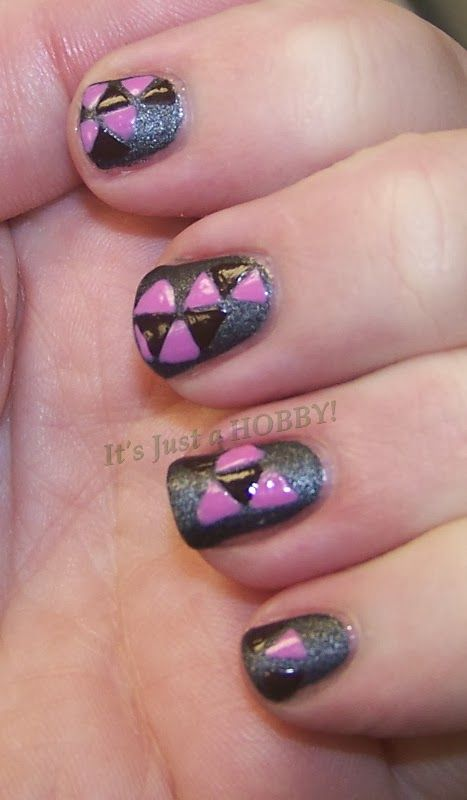 pink and brown triangles on matte grey