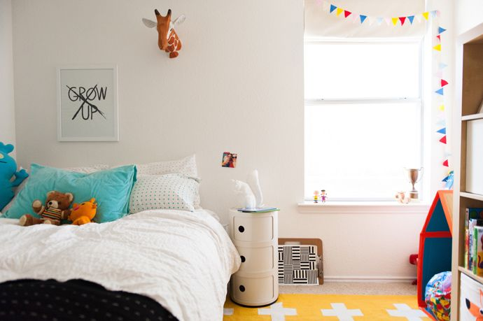Kids Bedroom Bunting modern boy's bedroom with white walls, white bedding, yellow rug