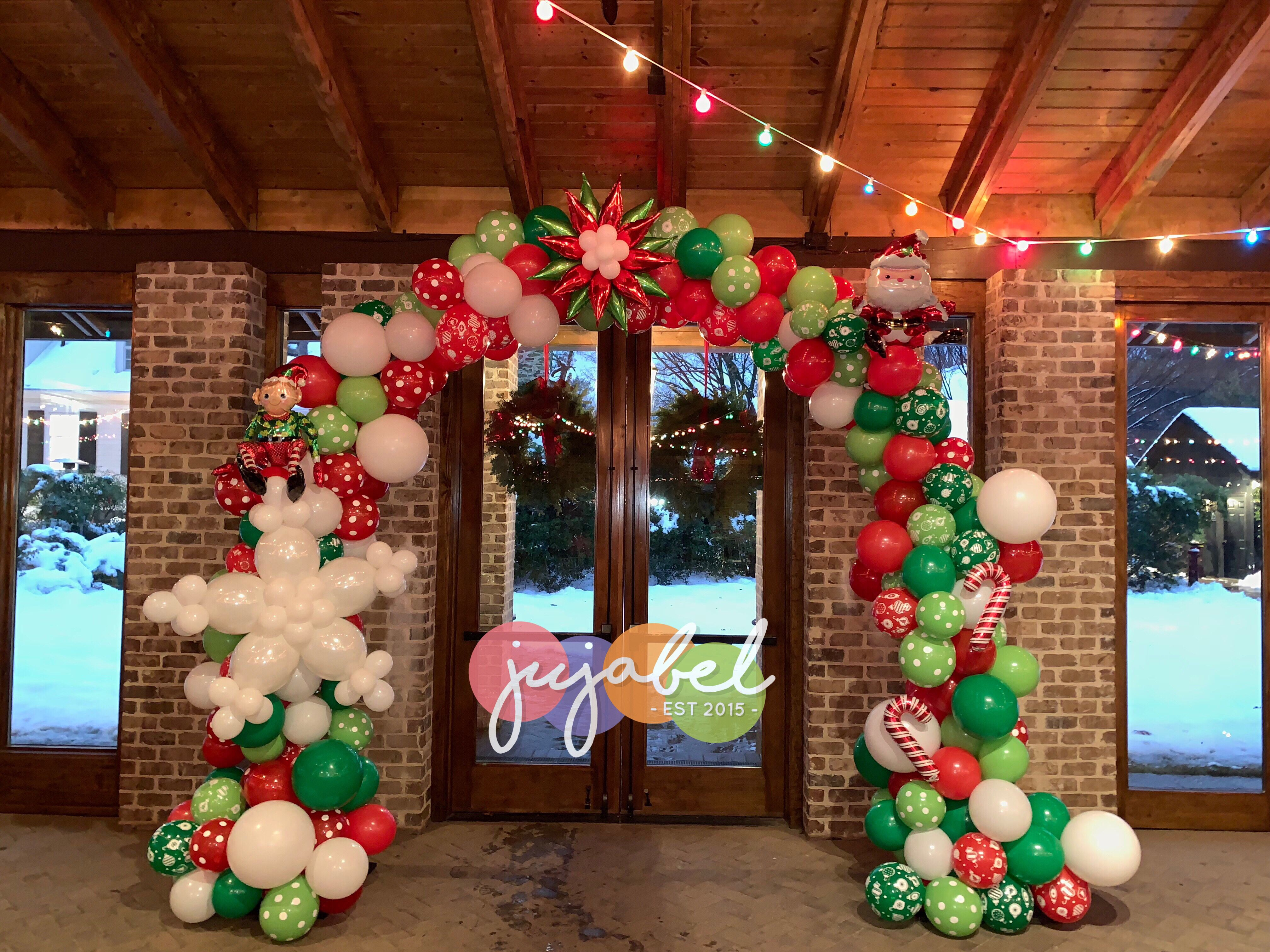 Fun And Festive Organic Christmas Themed Balloon Arch We