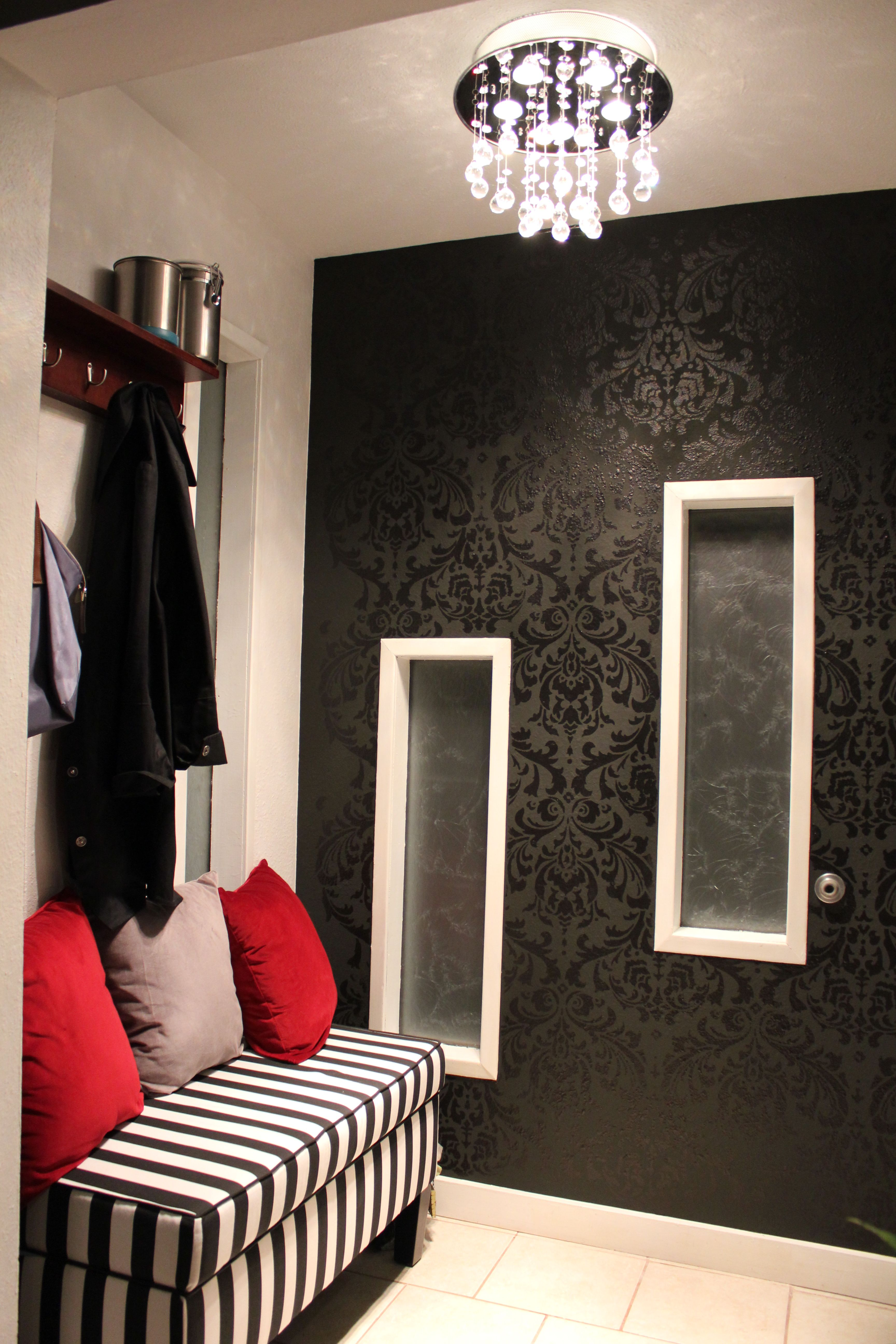 My entryway. Black gloss on black flat paint damask stencils.