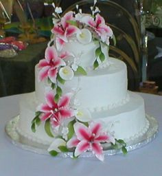 Round Wedding Cake Lilies Pink Purple Blue Google Search Cakes - Wedding Cake With Lilies