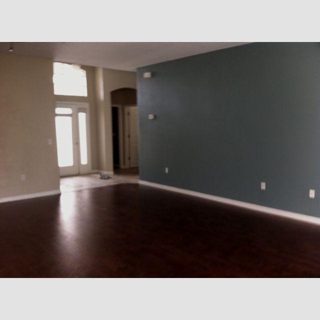 Select Surfaces Canyon Oak Laminate Flooring.