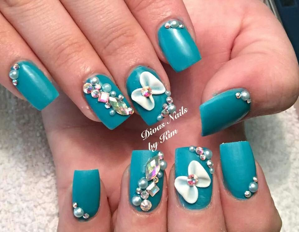 Beautiful turquoise colored nails with 3-D bows and bling! By Kim ...