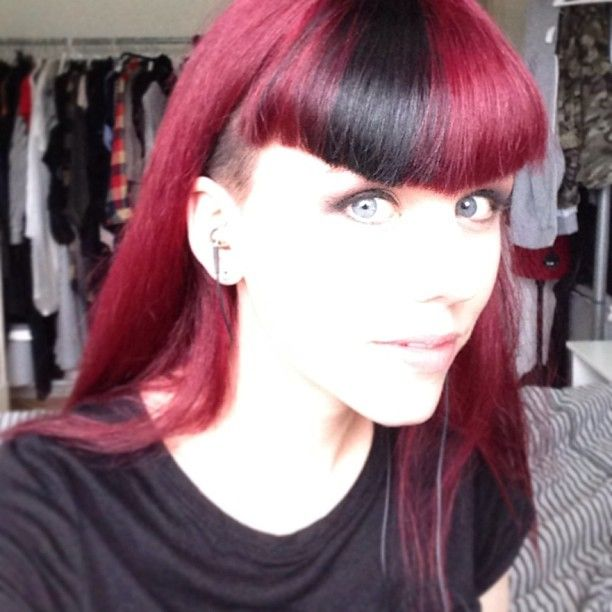 Alternative hair style. Cold rose red color with a hint of cerise/purple/fuchsia. Contrast black dark bang and shaved sides. Color block. #sidecut #undercut.