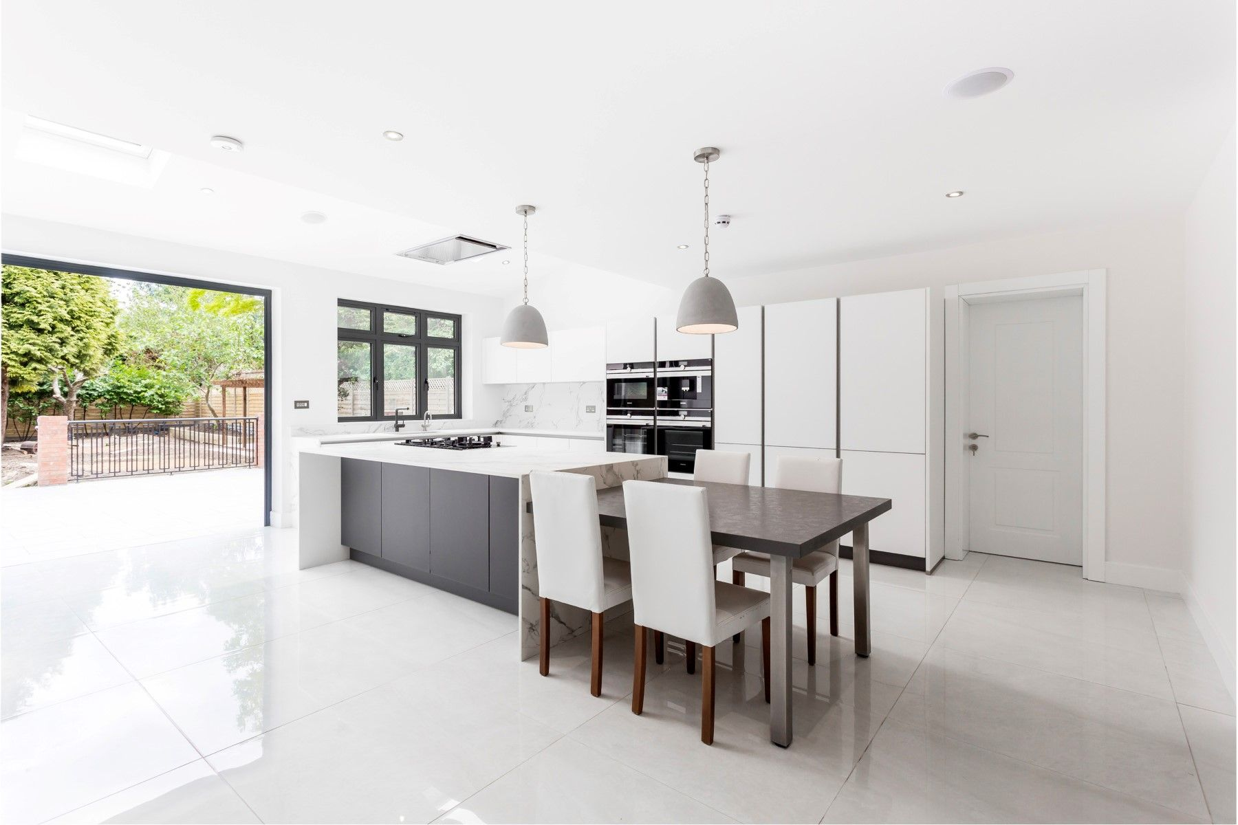 Nolte handleless kitchen in white and grey with Dekton