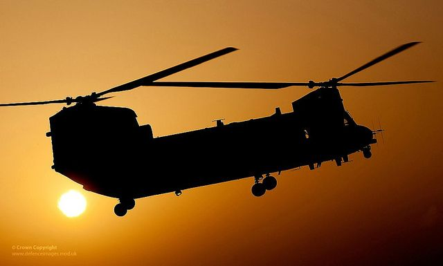 A RAF Chinook Helicopter Takes Off on a Dawn Mission Over Helmand, Afghanistan.  Photograph shows a Royal Air Force Chinook Mk2 from 1310 flight taking off on a dawn mission from Camp Bastion airfield in Helmand, Afghanistan.